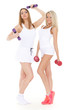 Young sports women with dumbbells.