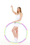 Woman with a hula-hoop. Fitness.
