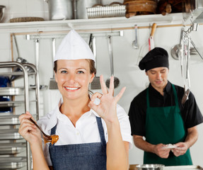 Happy Female Chef Gesturing Okay Sign