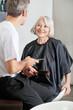 Customer And Hairstylist Having Conversation