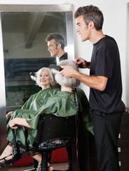 Hair Stylist Straightening Customer's Hair