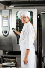 Chef Holding Handle Of Oven