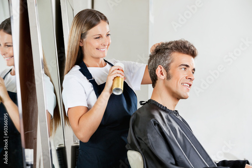 Hairstylist Setting Client's Hair At Parlor