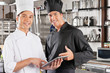 Happy Chefs Holding Digital Tablet