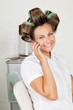 Happy Woman With Hair Curlers On Call