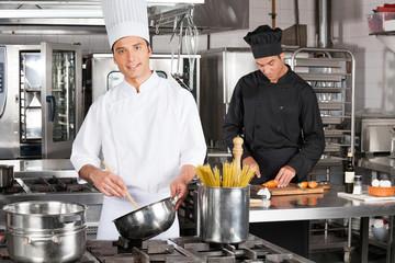 Young Chef Preparing Spaghetti