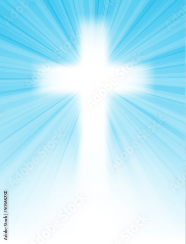 cross on blue sky, with sun rays