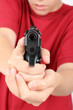 teens hand with gun, short focus on the gun