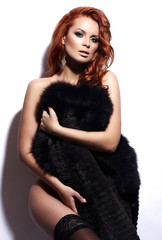 sexy redhead stylish nude young model  in fur coat