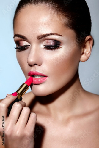 beautiful sexy model with bright makeup with lipstick