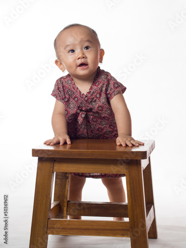 baby standing looking camera