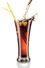 fresh cola juice and ice cubes splash in a glass