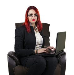 Serious business woman with laptop