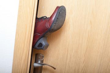 Leg in door.