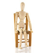 wooden pupput on chair