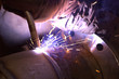 Welder in factory and sparks spread