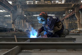 welder with protective equipment