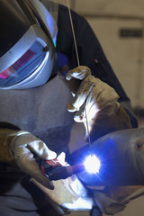 welder in factory welding inox