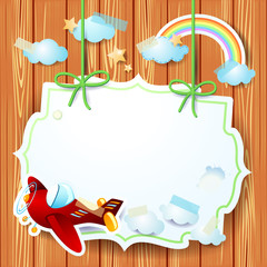 Airplane and label on wooden background