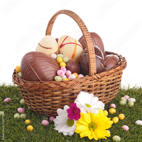 easter egg in wicker basket with flower