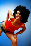 Smiling tanned woman with afro hair posing poster