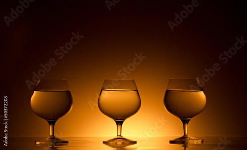 three glasses with beverage