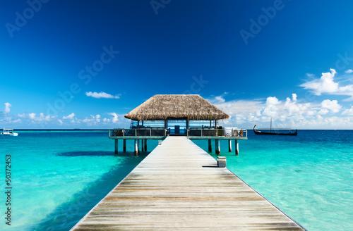 Fototapeta Beautiful beach with jetty