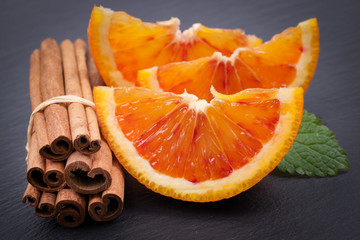 Oranges and cinnamon sticks