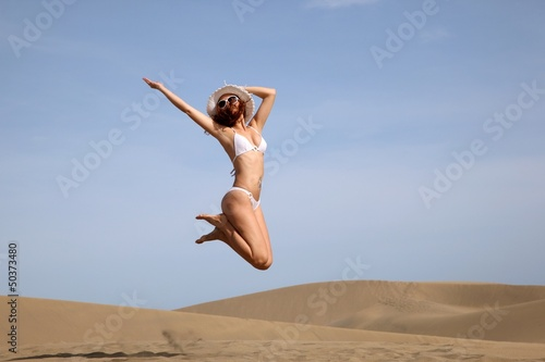 Young jumping bikini beauty on Gran Canaria