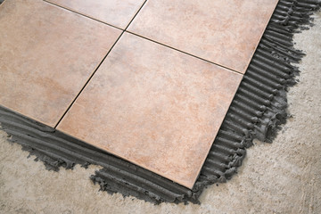 laying floor tiles