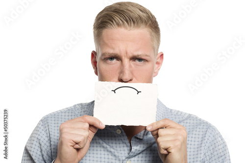 Upset businessman presenting blank white card.