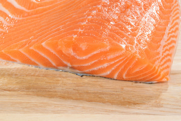 fresh raw salmon on wood