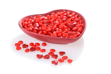 Valentines candy in a red heart bowl