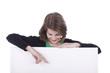 Mädchen zeigt auf leere Tafel - girl with messageboard