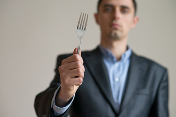 A man with a fork