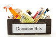 Black cardboard donation box with houseware product and food