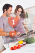 Smiling couple preparing dinner using futuristic interface