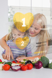 Mother and daughter chopping vegetables with yellow holographic