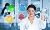 Serious chemist working with colourful dna helix diagram intefac
