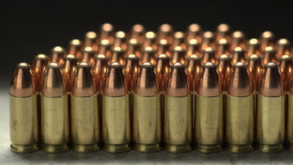 Macro shot of 9 mm handgun Bullets. Dollies to the right