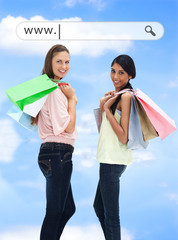 Happy girls with their shopping bags under address bar