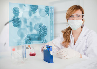 Scientist working in the lab with futuristic interface