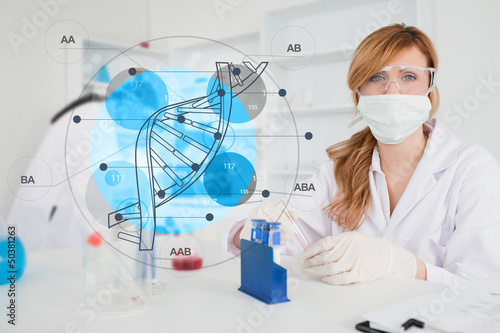 Scientist with protective mask using dna diagram interface