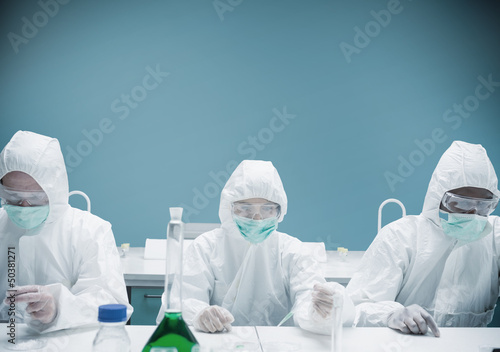 Chemists working in protective suits