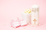 Christening candle with pink baby booties and gift box