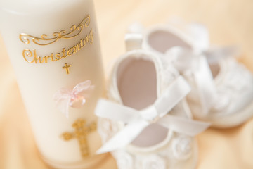Baptism candle and baby booties
