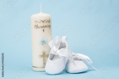 Christening candle for a boy with white baby booties - 50382242