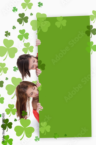 Girls holding blank green placard