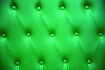 Emerald green color of upholstery leather pattern as background