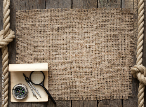 Old wooden planks and rope with compass vintage background
